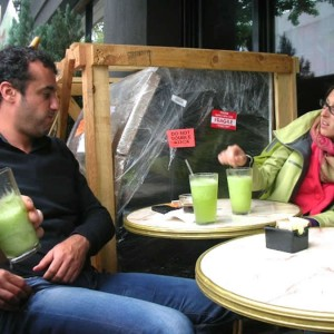MounesKhammar, mentor from Algeria, and CharlyFavier drink homemade limeade at a café next door to Kaufman Astoria Studios and discuss the next steps in the casting process